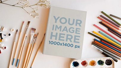 Book on a Creative Painter Desk with Brushes Palette and Pencils Moving in Stop Motion a13826