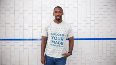 Black Man Wearing a Round Neck Tee Video Against a White Tiles Wall a13122