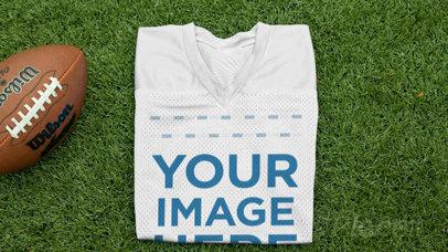 Custom Football Jerseys - Folded Jersey Near a Football at the Field a16935