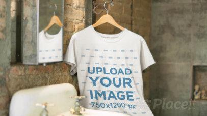 T-Shirt Video Mockup in a Hanger Inside a Vintage Bathroom a13138