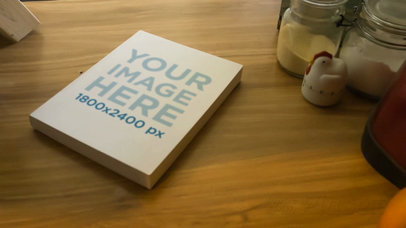 Video of a Book Lying on a Kitchen Wooden Table a14011