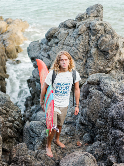 Surfer Dude Wearing a T-Shirt Mockup on the Rocks a18801