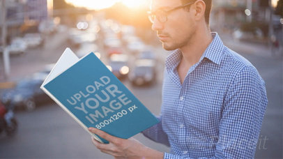 Hipster Guy Without Beard Reading a Book Stop Motion While the Sun Sets on the City a13855
