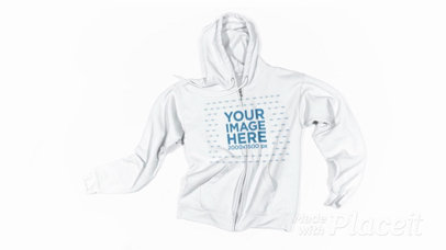 Stop Motion of a FullZip Hoodie on a White Surface with Moving Laces a13268