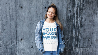 Beautiful Girl Wearing a Denim Jacket and a Tshirt Stop Motion Against a Concrete Wall a13236