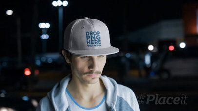 Young White Man Wearing a Snapback Hat Video in the City at Night a14166