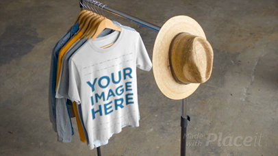 T-Shirt Video Hanging on a Clothing Rack with a Hat a13802