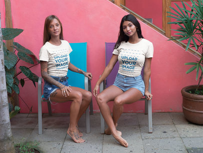 Two Teens Wearing Tshirts Mockup Sitting on Pool Chairs a18794