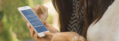 Mockup of Two Women Using an iPhone 6 Outdoors Wide