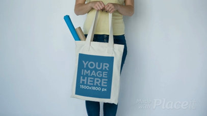 Girl Slightly Swinging a Tote Bag Standing Against a White Wall Video a13847