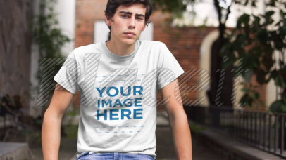 T-Shirt Mockup Video of a Trendy Young Man Sitting in a Park a12135-121916b