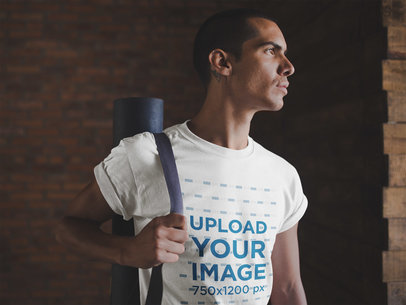 Mockup of a Man Wearing a T-Shirt Mockup Carrying a Yoga Mat a19967