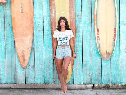 Latin Girl Near Surfboards Wearing a Tshirt Mockup a18805