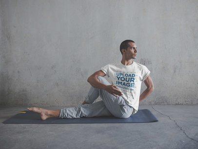 Man Wearing a T-Shirt Mockup Doing a Yoga Pose a19961