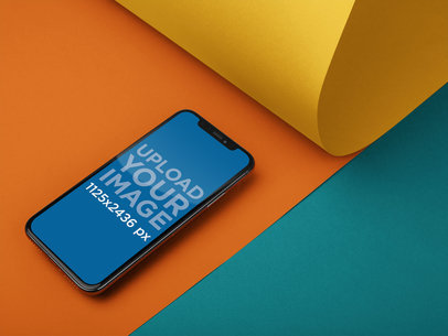 iPhone X Mockup Lying on Three Pasteboards a20006