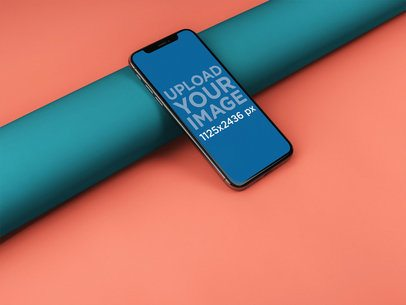 iPhone X Template Lying Against a Tube a20090