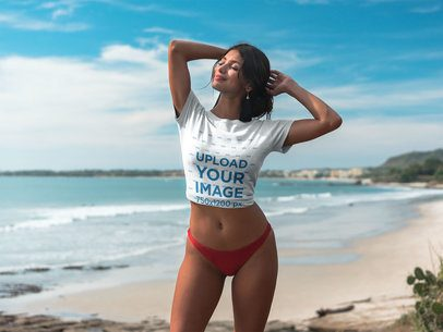 Beautiful Latin Girl Wearing a Crop Top Tee Mockup at the Beach a18831