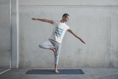 Man Balancing Wearing a T-Shirt Mockup at the Yoga Class a20029