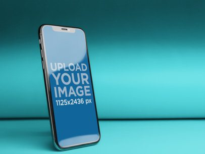 Angled iPhone X Mockup in a Solid Color Room a20083