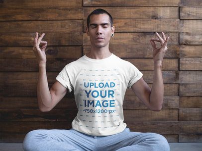 Man in a Seated Mudra Pose Wearing a T-Shirt Mockup a20033