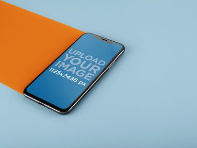 iPhone X Mockup Lying on a Double Colored Surface a20086
