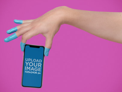 iPhone 11 Pro Mockup Being Held by a Hand with Painted Fingers a19306