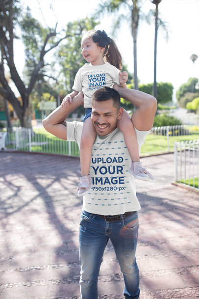 Dad and Daughter Wearing T-Shirts Mockup at a Park a19845