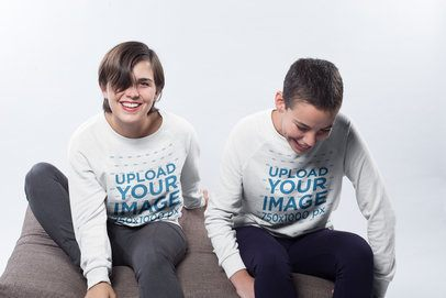 Mockup of a Happy Couple Wearing Crewneck Sweatshirts in a White Room a19980