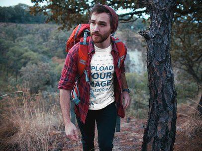 Man Wearing a Tshirt Mockup Trekking at the Mountains a19036