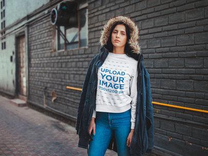 Woman Wearing a Crewneck Sweatshirt Mockup Outside a Warehouse a19184