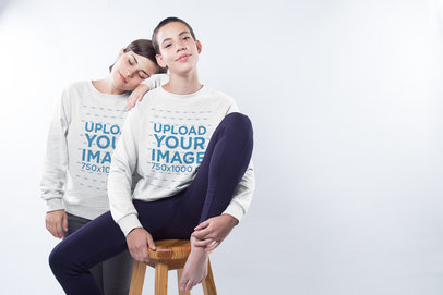 LGBT Pride Sweatshirt Mockup of a Lesbian Couple Wearing Sweaters in a Studio a19981