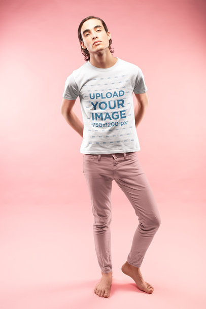 Man Posing Wearing a T-Shirt Mockup and Pink Pants a19663