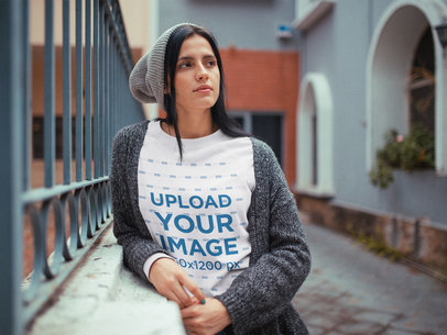 Woman Wearing a Winter Crewneck Sweatshirt Template while Standing Outside her House a19179