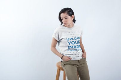 T-Shirt Mockup of a Girl Standing in a White Room a19785