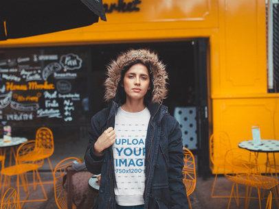 White Woman Wearing a Crewneck Sweatshirt Mockup Outside an Orange Coffee Shop a19182