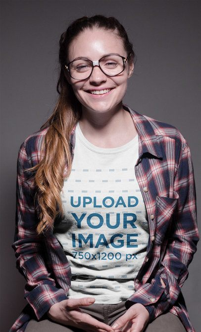 Smiling Geek Woman Wearing a Round Neck Tee Mockup and Glasses a19265