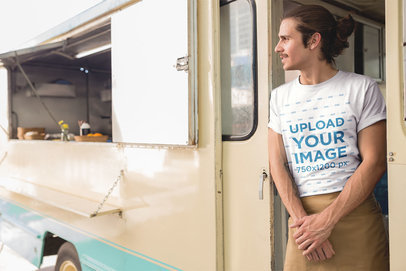 Man Wearing a T-Shirt Mockup Waiting on his Food Truck a20303