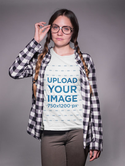 Nerd Girl with Braids Wearing a T-Shirt Mockup and Glasses a19266