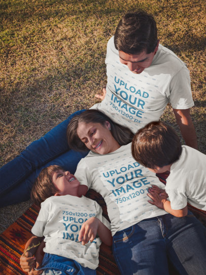 Family of Four Mockup Wearing T-Shirts while at the Park a20199