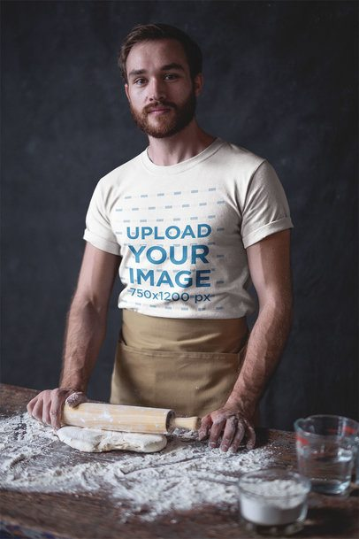 Portrait of a Baker Wearing a T-Shirt Mockup While Kneading with a Rolling Pin a20265
