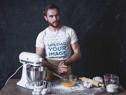 Baker Wearing a Round Neck Tee Mockup Standing at his Work Table a20271
