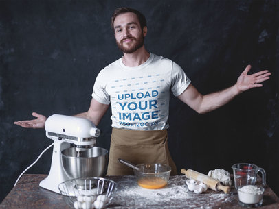Satisfied Baker Wearing a T-Shirt Mockup at his Work Table a20272