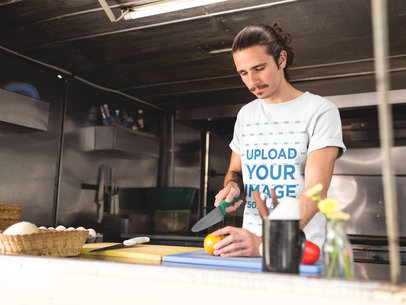Man Wearing a T-Shirt Mockup Cooking in his Food Truck a20297