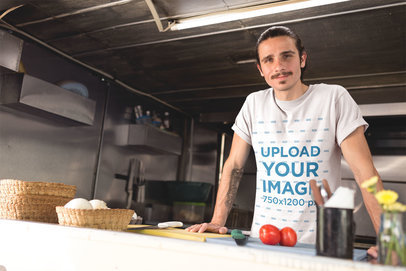 Smiling Man Wearing a Round Neck Tee Mockup Inside his Food Truck Kitchen a20299