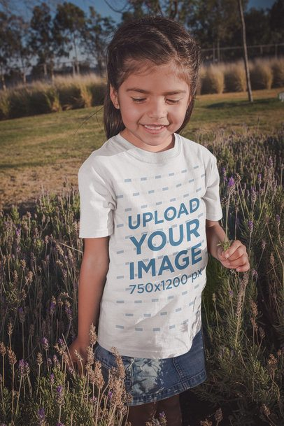 Little Girl Wearing a Tshirt Mockup with Lavender Flowers a20200