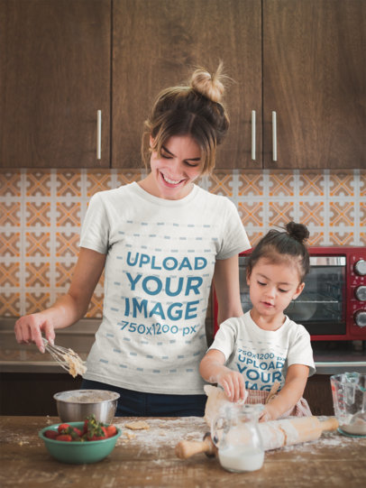 Happy Woman Cooking with her Daughter Wearing T-Shirts Mockup a20291