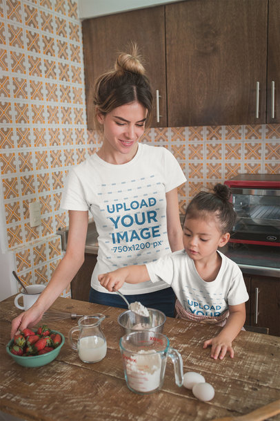 Woman and Daughter Wearing T-Shirts Mockup Baking in the Kitchen a20289