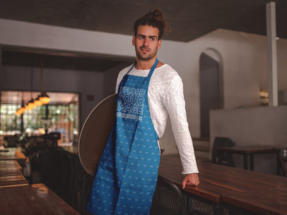 Hipster Dude Wearing an Apron Mockup at a Restaurant a19885