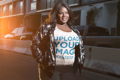 Happy Black Woman Wearing a Plus Size Tee Mockup on the Street a18225