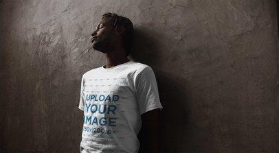 Urban Shot of a Black Dude with Short Dreadlocks Wearing a T-Shirt Mockup a20111